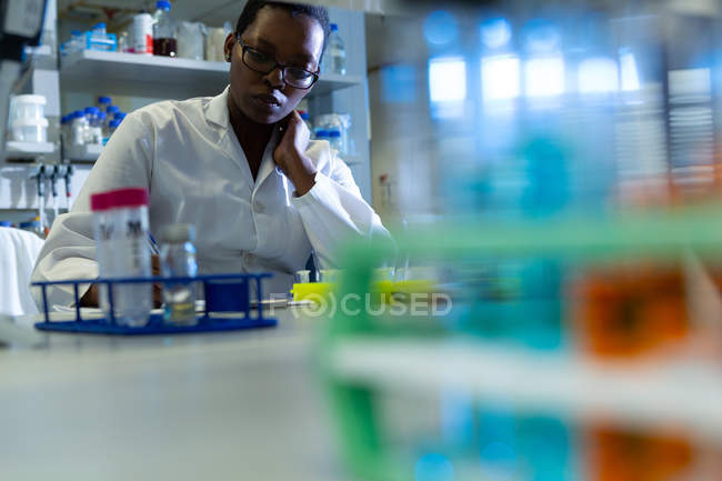Attentive female scientist experimenting in laboratory — Stock Photo