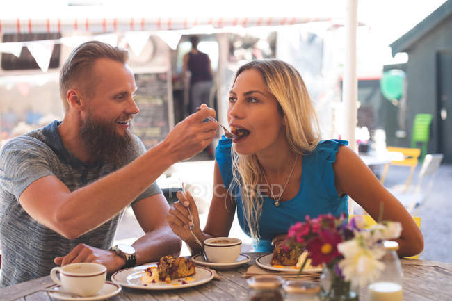 Romantic couple having breakfast in outdoor cafe — Stock Photo
