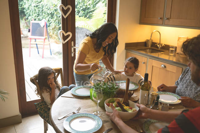 Mother serving a meal to her daughter at home — Stock Photo