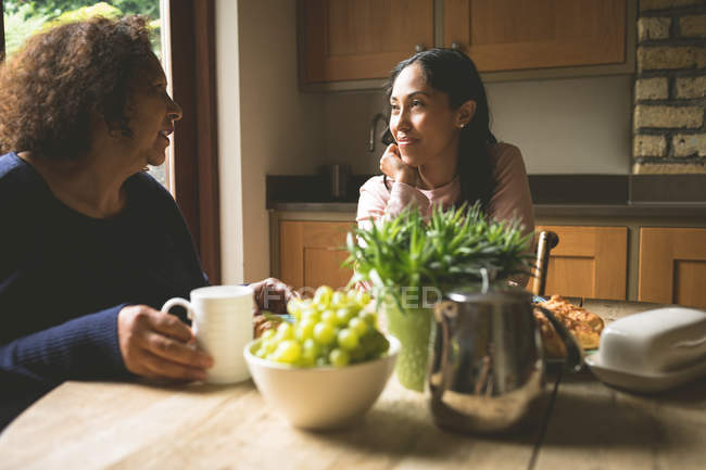 Mother and daughter interacting with each other at home — Stock Photo