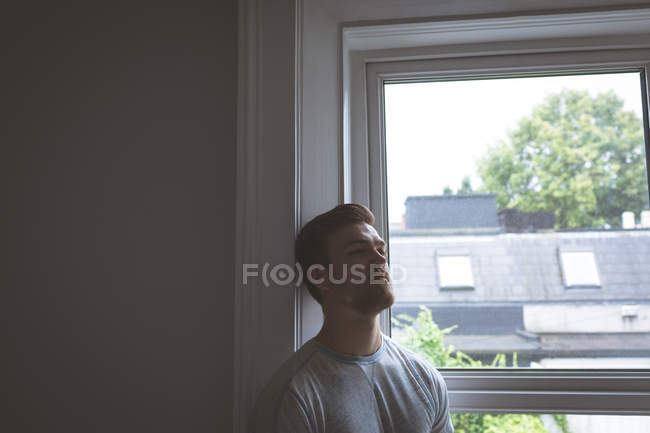 Worried man standing at home — Stock Photo