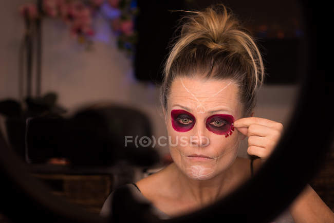Close-up of woman dressing up for halloween celebration — Stock Photo