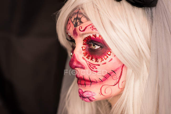 Woman with scary make-up on face for halloween celebration — Stock Photo