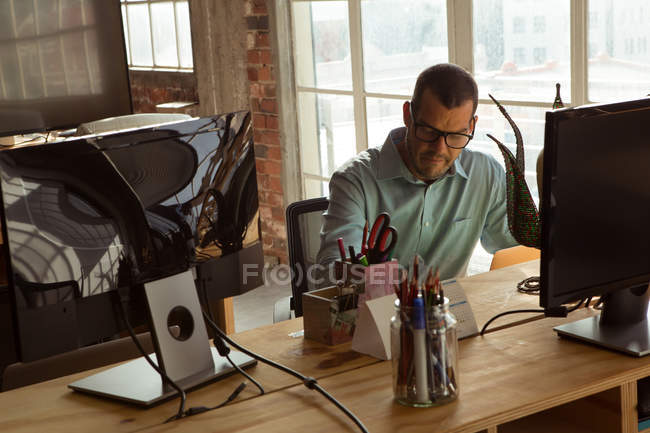 Attentive executive working at desk in office — Stock Photo