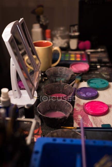Close-up of various paint and make-up box kept on table — Stock Photo