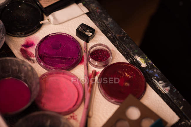 Close-up of body painting colors on table — Stock Photo
