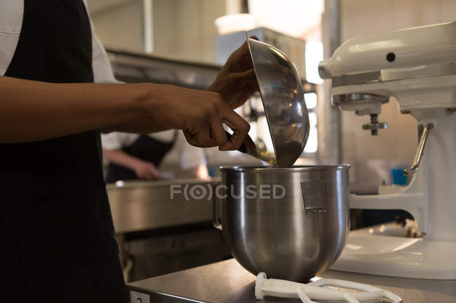 Mid section of chef working in kitchen at restaurant — Stock Photo