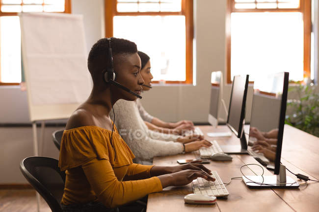 Side view of business colleagues working on computer in office — Stock Photo