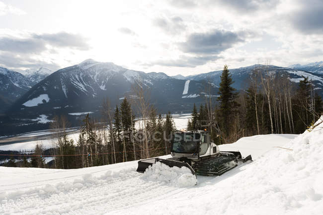 Snowplow truck cleaning snow during winter — Stock Photo