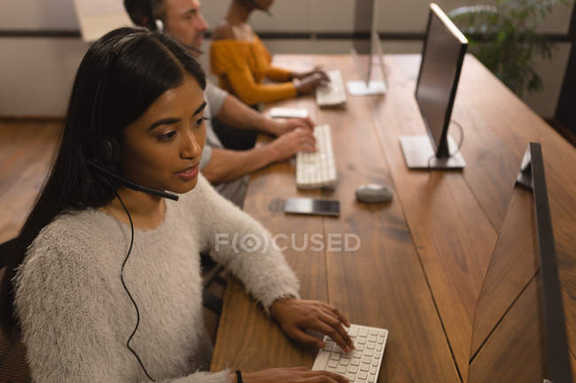 Close-up of female executive working in office — Stock Photo