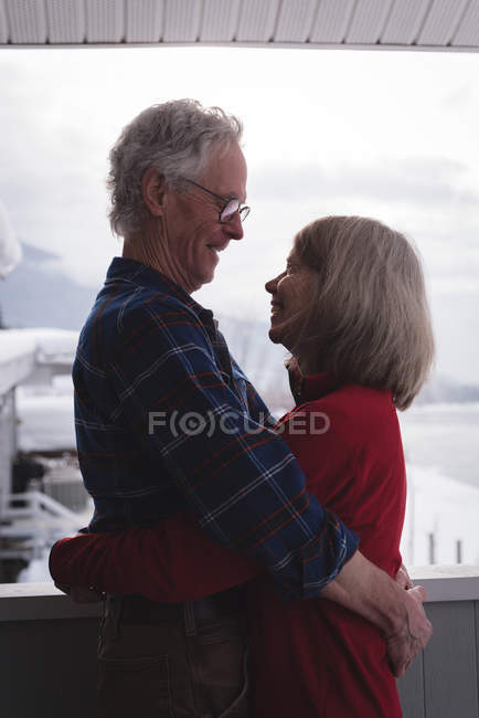 Happy couple embracing each other at home — Stock Photo
