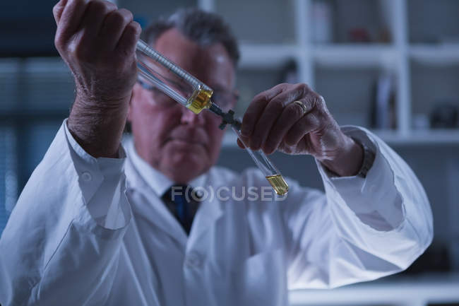 Close-up of male scientist experimenting in laboratory — Stock Photo