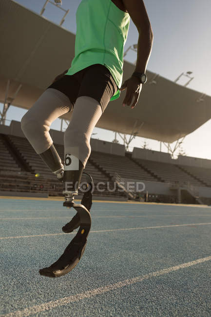 Low section of disabled athlete running on a running track — Stock Photo