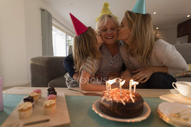 Multi-generation family celebrating birthday in living room at home — Stock Photo
