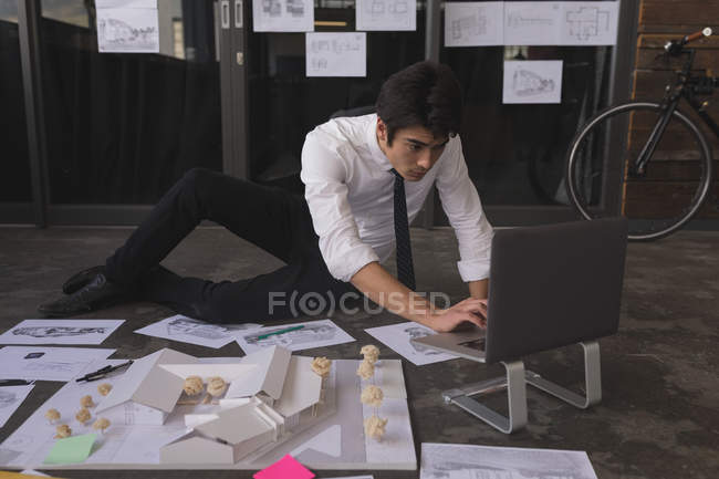 Attentive male executive working on laptop at office — Stock Photo