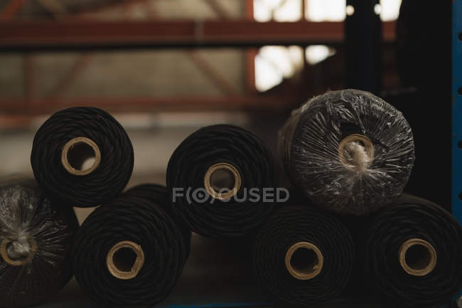 Close-up of rope roll arranged in rack at rope making industry — Stock Photo