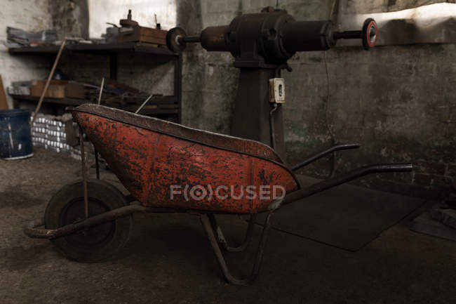 Close-up of wheelbarrow in forge workshop — Stock Photo