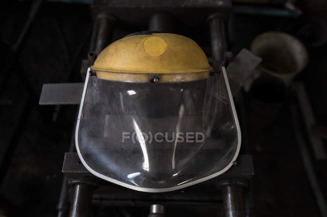 Close-up of protective helmet in workshop — Stock Photo