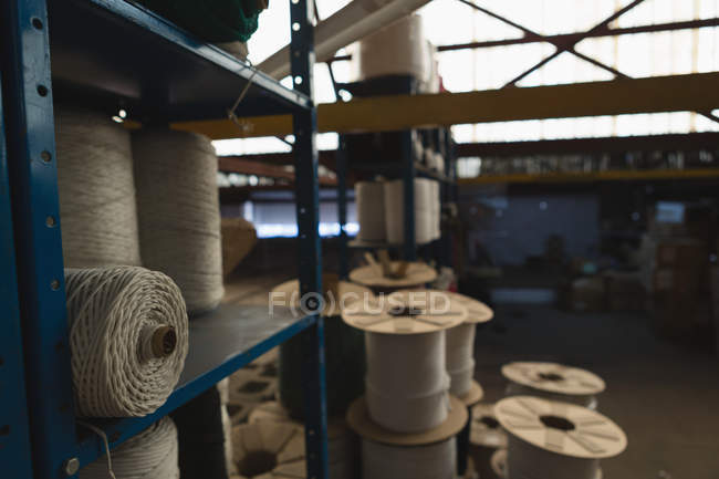Rope roll arranged in pallet rack at rope making industry — Stock Photo
