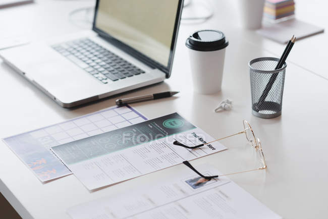 Laptop, document and office stationery on the desk in office — Stock Photo