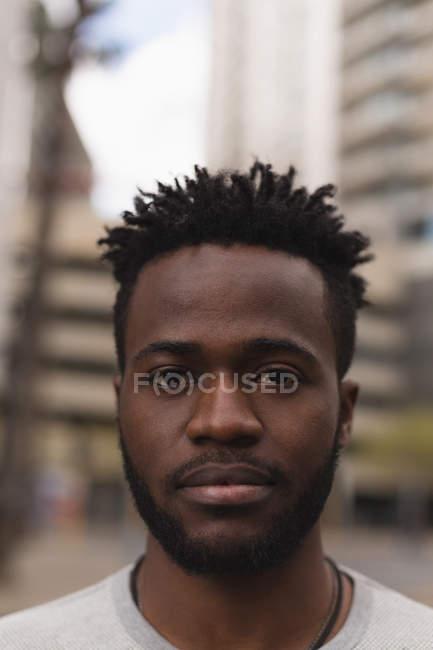 Portrait of man standing in city street — Stock Photo