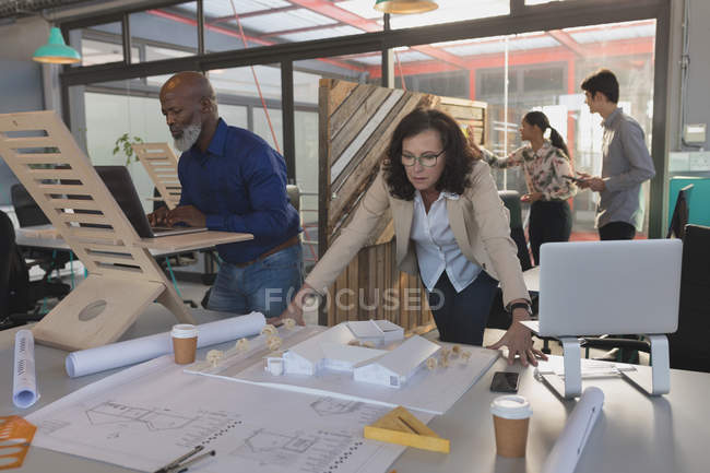 Team of executives working in office — Stock Photo