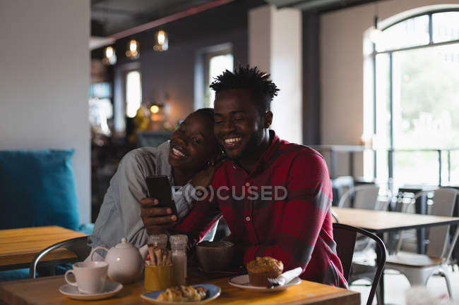 Happy couple taking selfie in cafe — Stock Photo