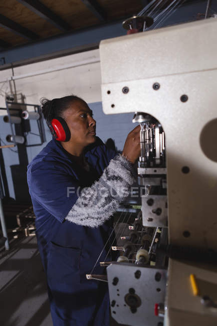 Side view of worker working in rope making industry — Stock Photo