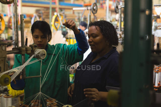 Attentive coworker working in rope making industry — Stock Photo