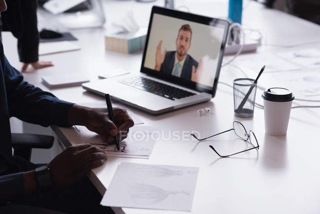 Business people having a video conference meeting in the office — Stock Photo
