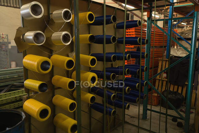 Thread rolls arranged in rack at rope making industry — Stock Photo