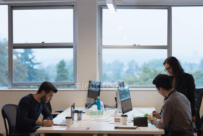 Concentrated business people working in the office — Stock Photo