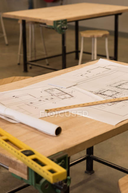 Blueprints and instruments on table in workshop — Stock Photo