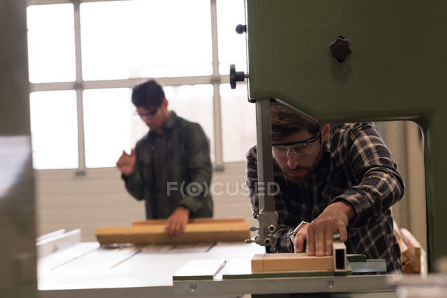 Attentive craftsmen working in industrial workshop — Stock Photo