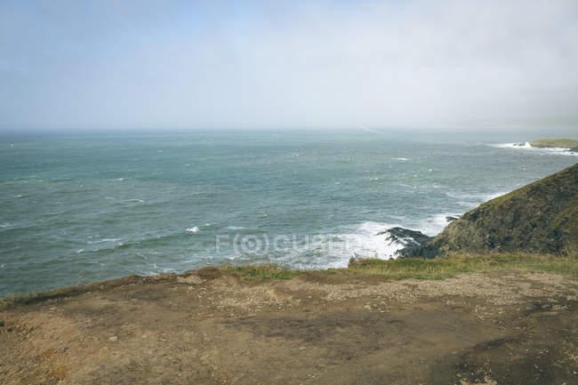Scenery of cliffs overlooking ocean in County Cork, Ireland. — Stock Photo