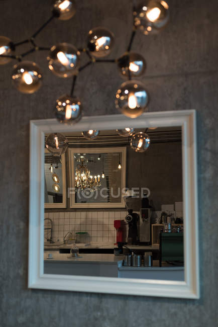 Reflection of kitchen in mirror in cafe — Stock Photo