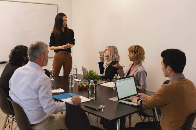 Executives discussing in conference room at office — Stock Photo