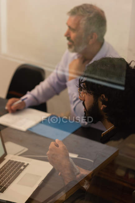Male business executives working in office — Stock Photo