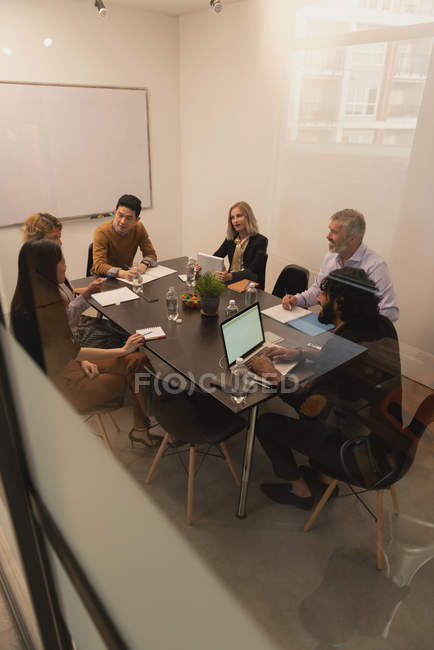 Executives discussing in meeting room at office — Stock Photo