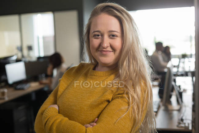 Portrait of female executive looking at camera in office — Stock Photo