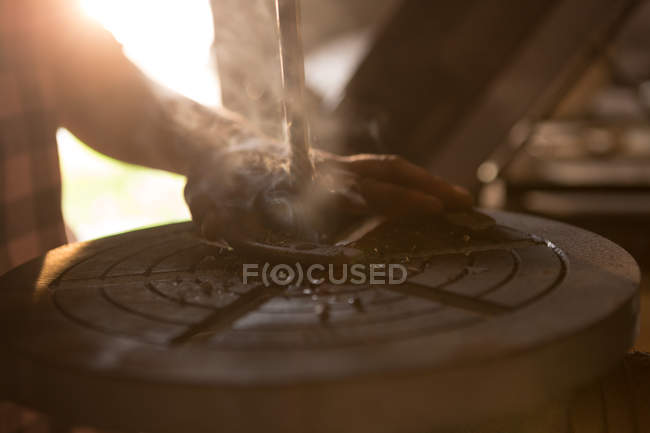 Close-up of female metalsmith using radial drilling machine in factory — Stock Photo