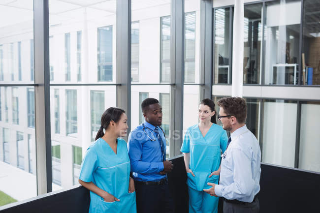 Doctors and nurse interacting with each other in hospital — Stock Photo