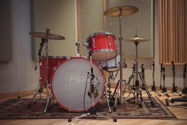Drum kit in recording studio interior — Stock Photo