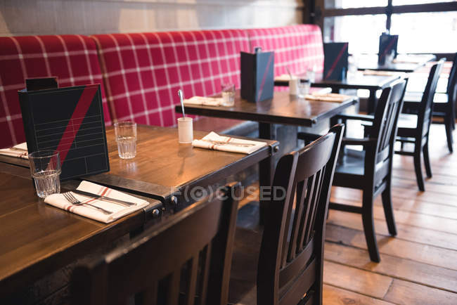 Interior of empty bar with tables and chairs — Stock Photo