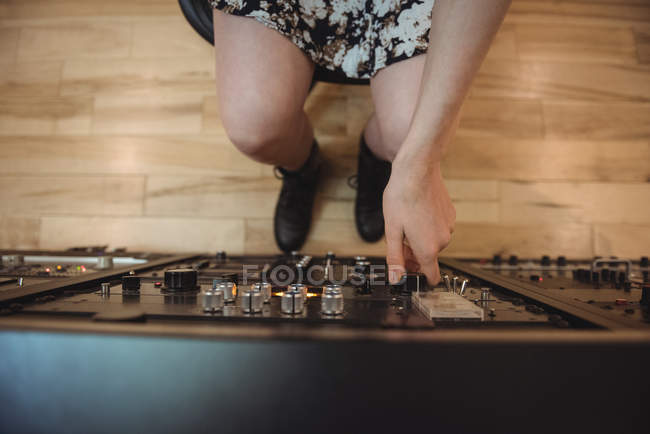 Close-up of audio engineer using sound mixer in recording studio — Stock Photo