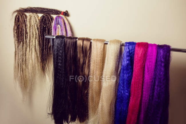 Close-up of artificial dreadlocks materials hanging in shop — Stock Photo