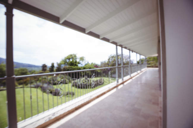 Exterior of a house with empty veranda and lawn — Stock Photo