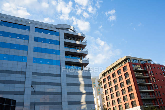 Modern office buildings in city, low angle view — Stock Photo