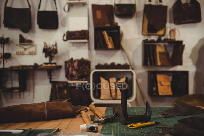 Various work tools on table in artisan workshop — Stock Photo