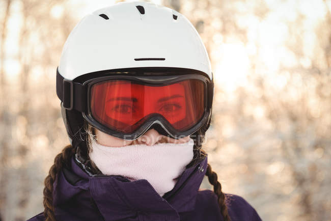 Close-up of woman in ski goggles and jacket — Stock Photo